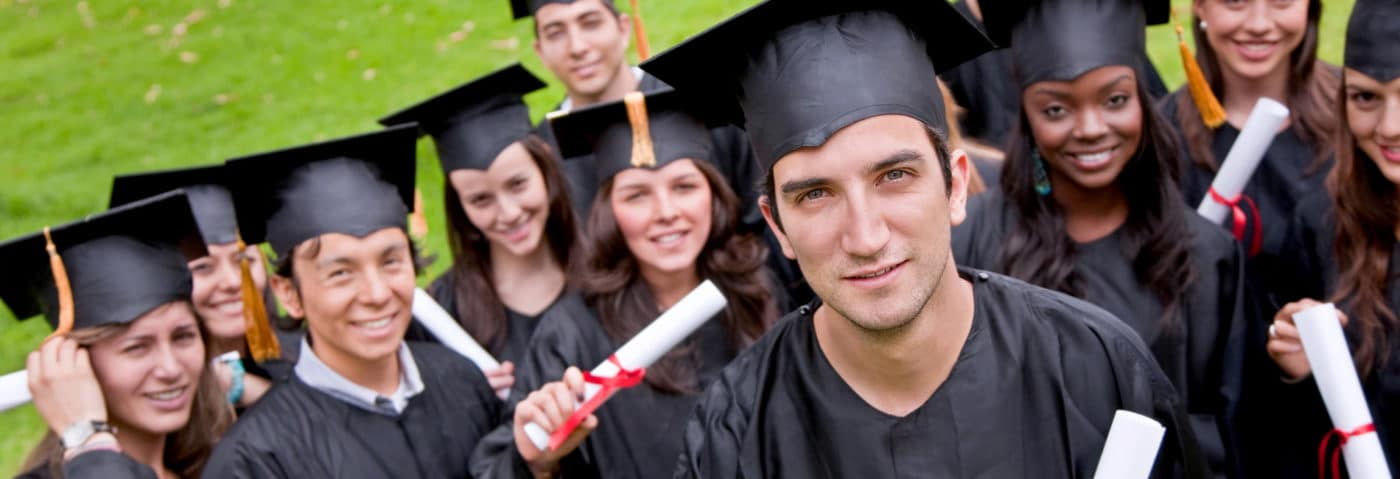 Students in graduation gowns and hats