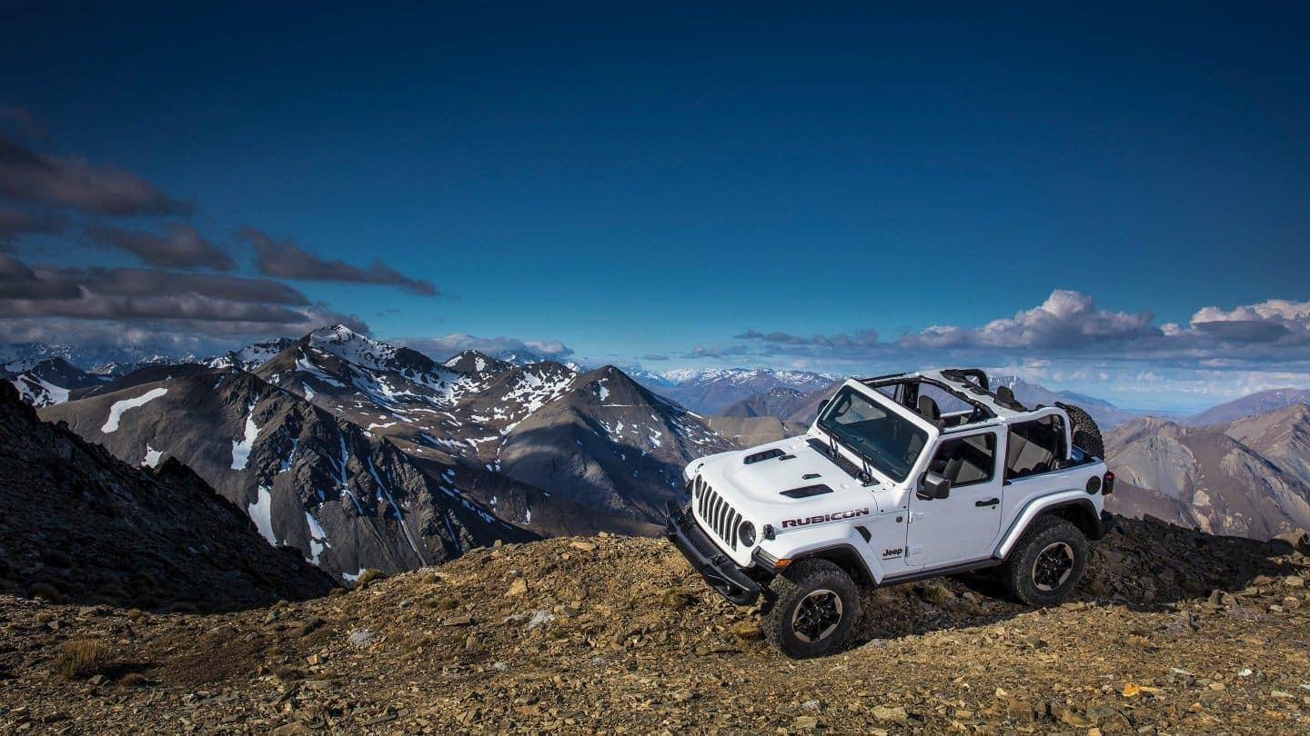 White Jeep Wrangler on a mountain