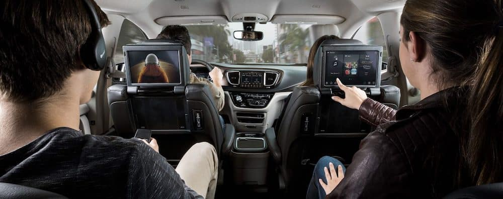 Family in Car Using Uconnect entertainment screens