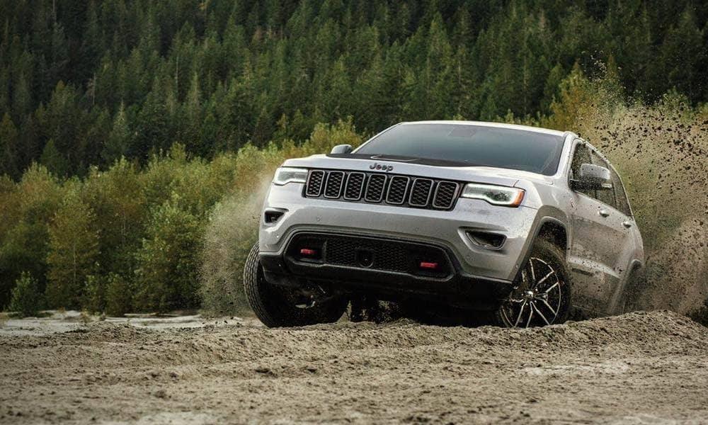 Gray 2019 Jeep Grand Cherokee climbing over a hill