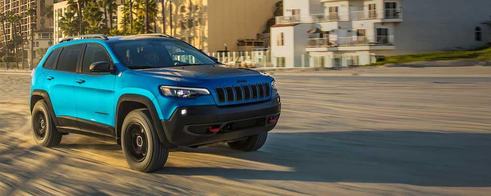 Blue 2019 Jeep Cherokee on Sand