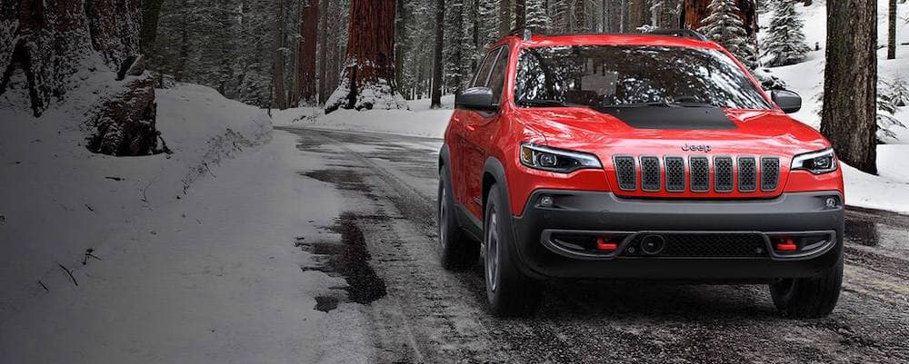 Red 2019 Jeep Cherokee in Snow