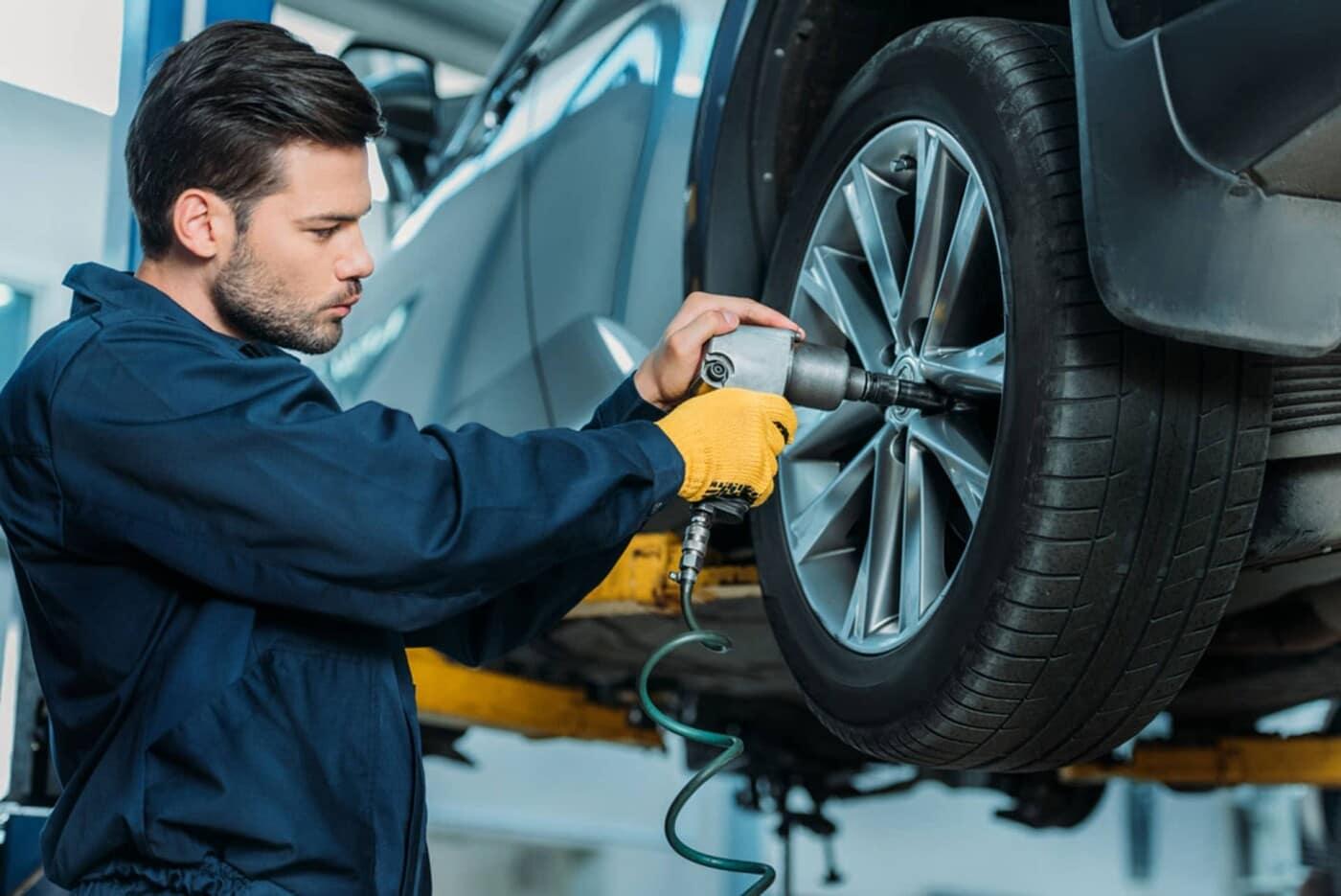 man servicing tire