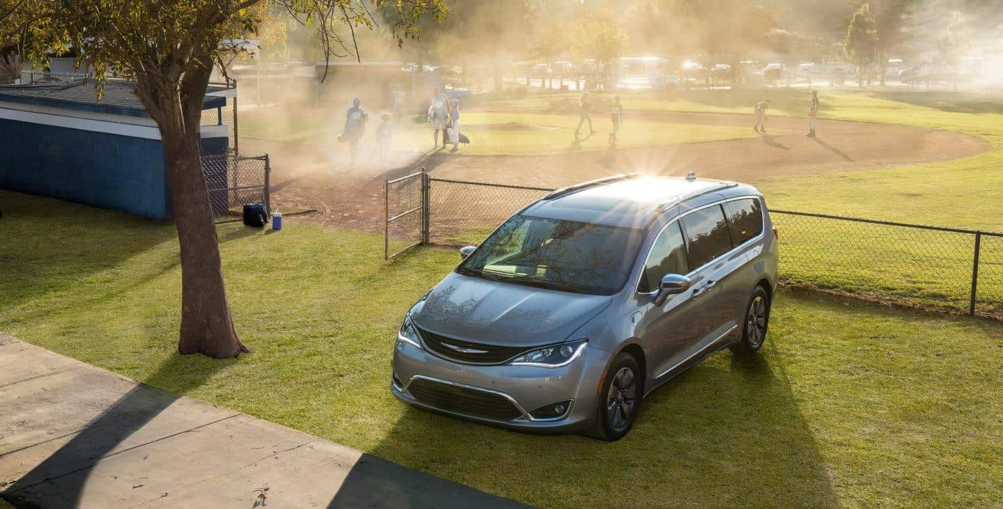 2018 Chrysler Pacifica parked by a baseball field