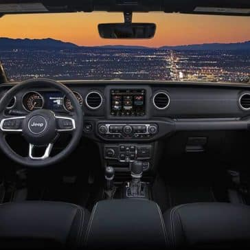 2019 Jeep Wrangler front of cabin at sunset