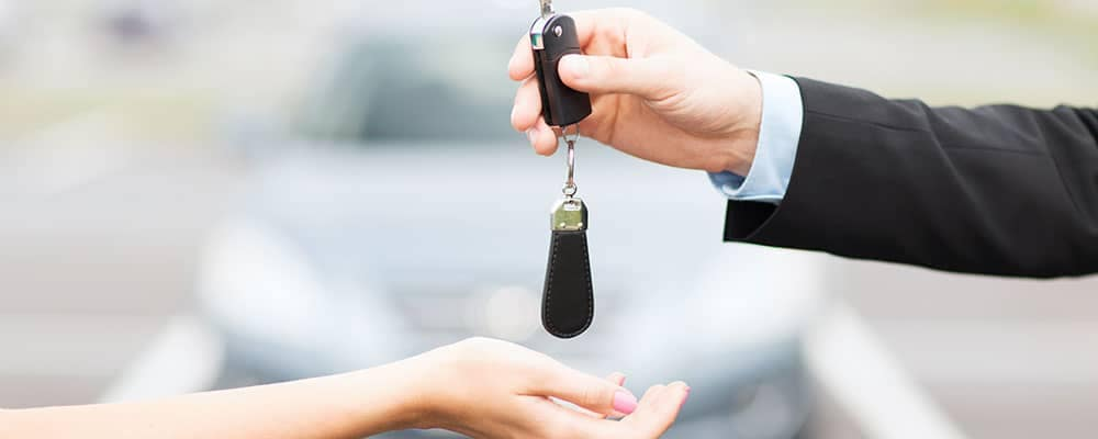 Handing over key to car