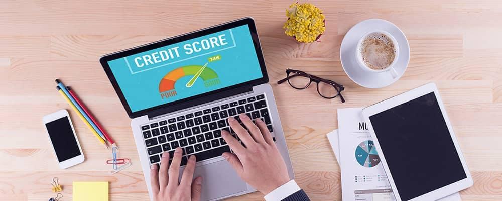 Laptop showing credit score
