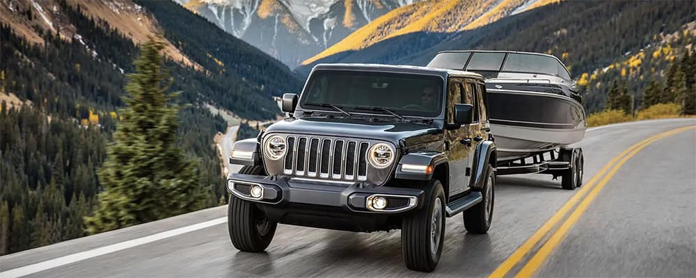 2019 Jeep Wrangler towing a boat banner