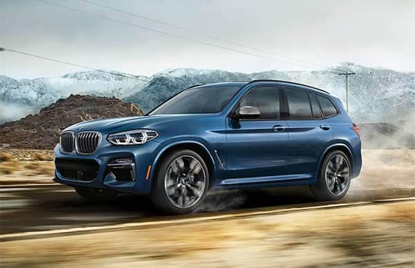 BMW X3 Driving on Dirt Road