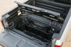A view of the 2021 Ridgeline's hidden cargo space, located near the tailgate