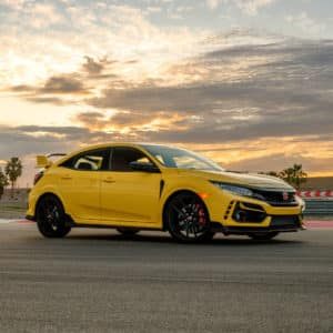 The exterior view of the left side of the phoenix yellow 2021 Limited Edition Honda Civic Type R