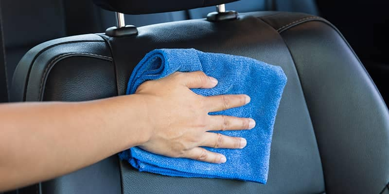 Cleaning car seats with microfiber towel