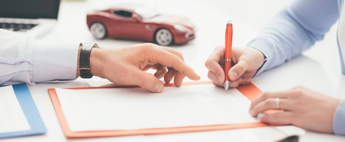 Driver Signing Car Loan Documents