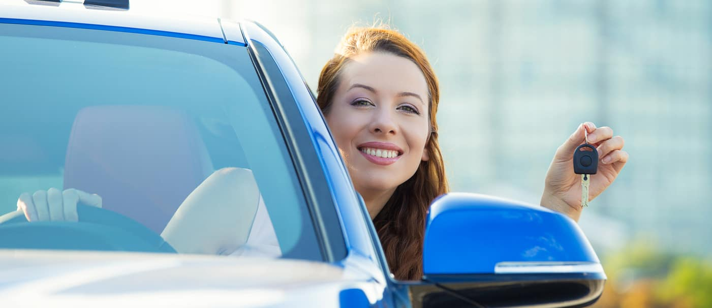 Woman in Newly Purchased Car