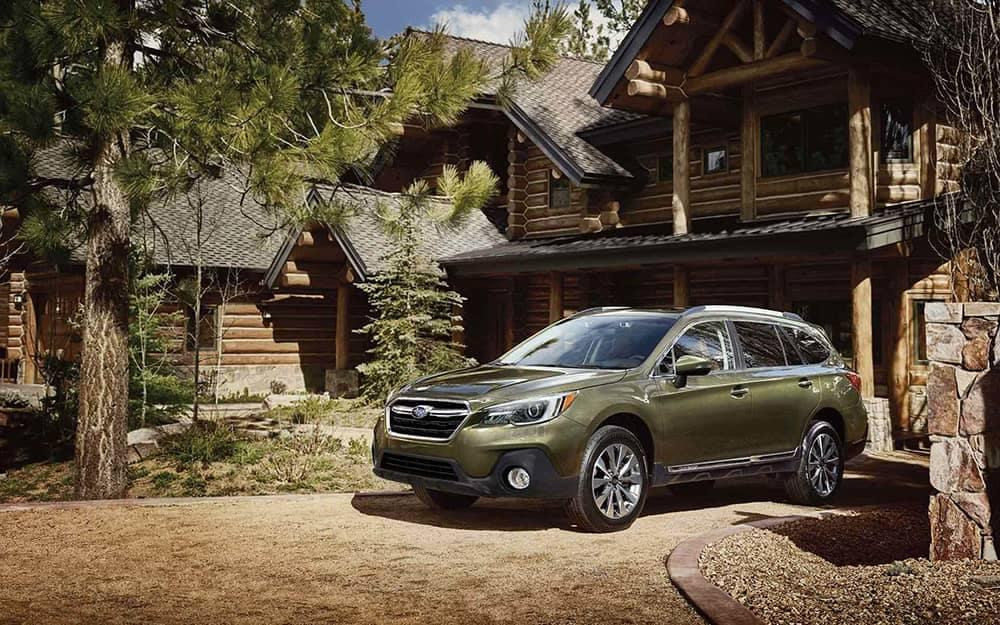 2019 Subaru Outback Parked Outside Log Cabin Home