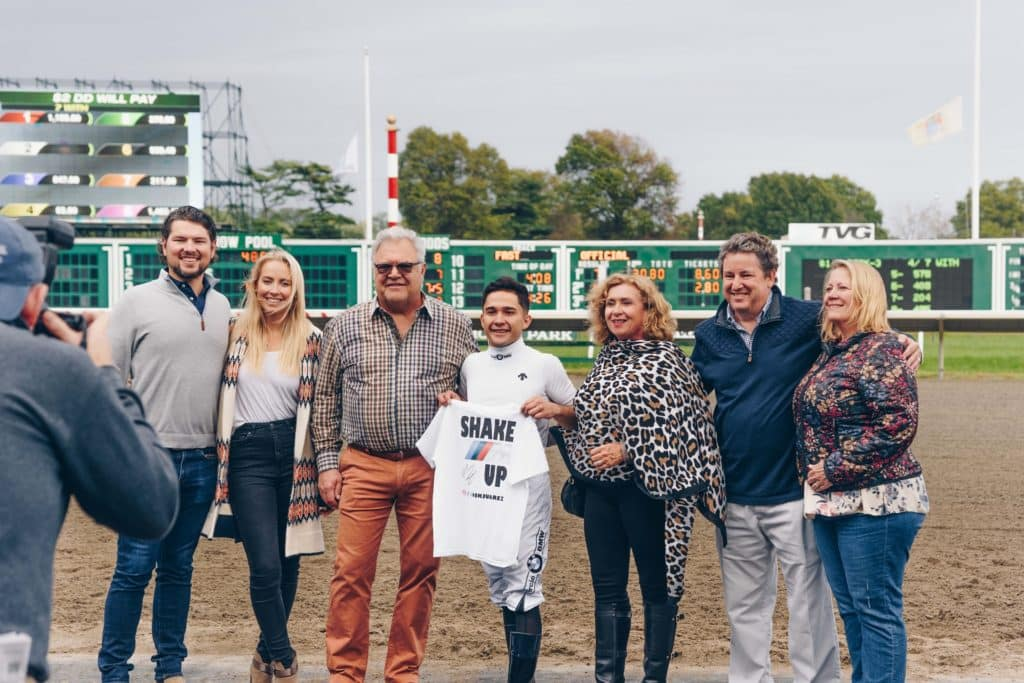 In the winner's circle with Nik Juarez (center). From left, Thomas DeFelice, III, Kaitlyn Campi, Circle BMW President, Tom DeFelice, Nik Juarez, Valarie DeFelice, Circle BMW GM, Larry Powell and Kathy Powell.