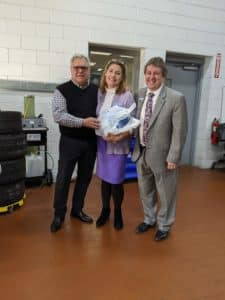 Our Marketing Director, Pamela Marshall, is not keen on her picture, but she was happy to receive her Thanksgiving turkey! She is pictured with GM, Larry Powell (left) and Circle BMW President, Tom DeFelice (right).