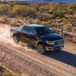ram 1500 driving down dirt road