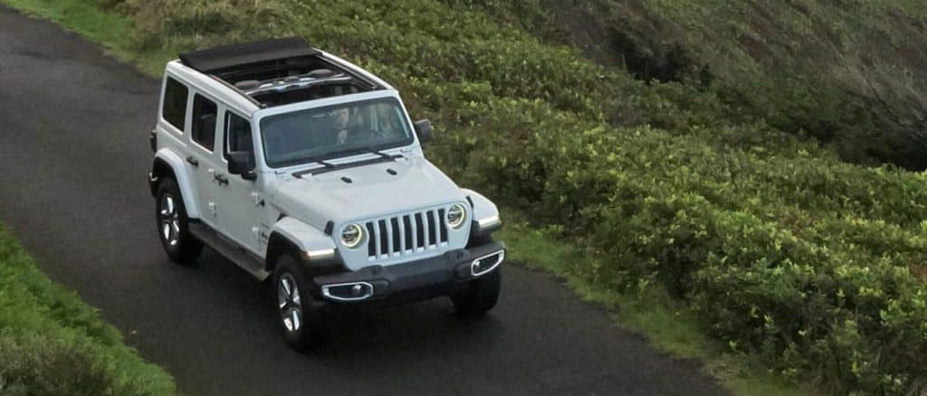 Jeep driving down road