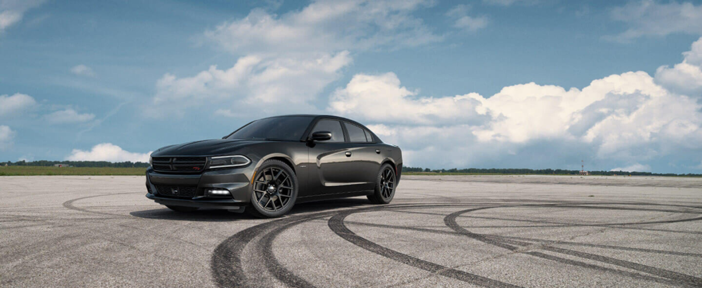 Black Dodge Charger RT on a track