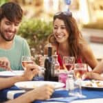 Friends Eating at Fine Restaurant Outside