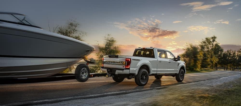 A 2020 Ford F-250 towing a large boat