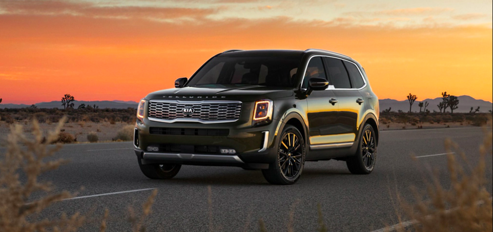 A financed, pre-owned Kia Telluride driving on an open road