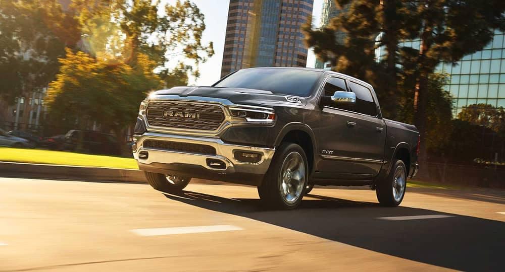 2019 Ram 1500 drives down city street