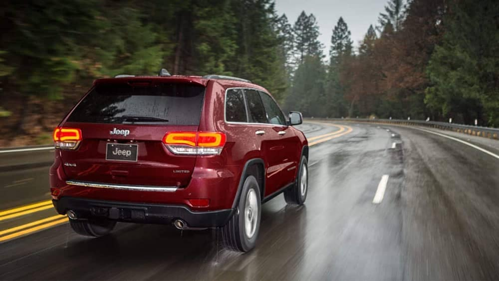 2019 Jeep Grand Cherokee on a rain-swept forest drive