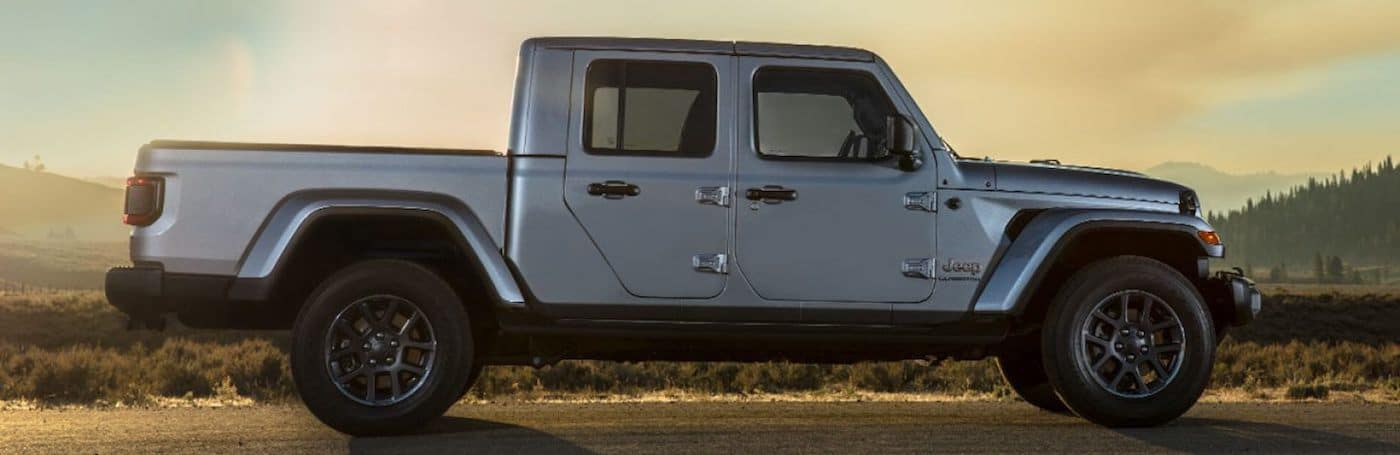Profile view of a 2020 Jeep Gladiator at sunset with mountains in the background