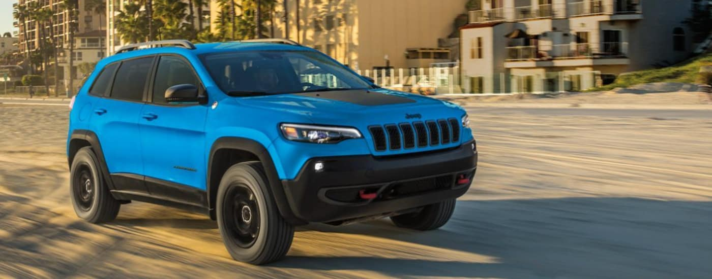 2020 Jeep Cherokee driving down sand