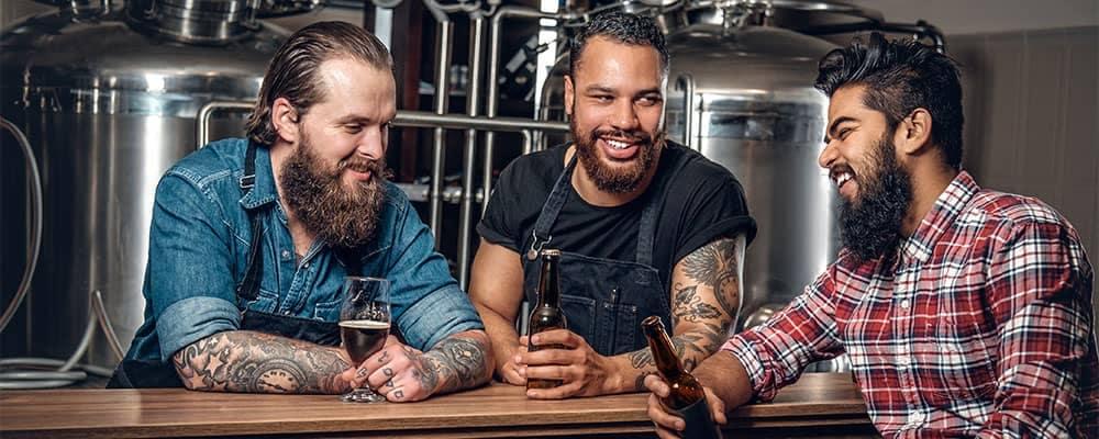 Three men at micro brewery