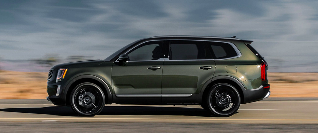 Profile view of a 2020 Kia Telluride driving on a highway