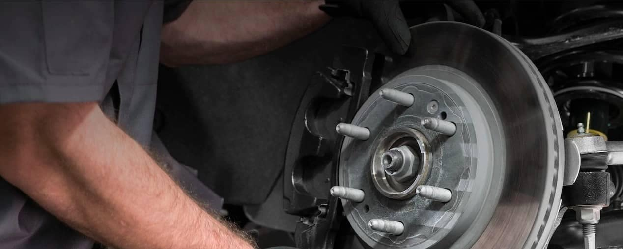 service tech replaces brakes