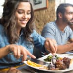 Couple having lunch at rustic gourmet restaurant