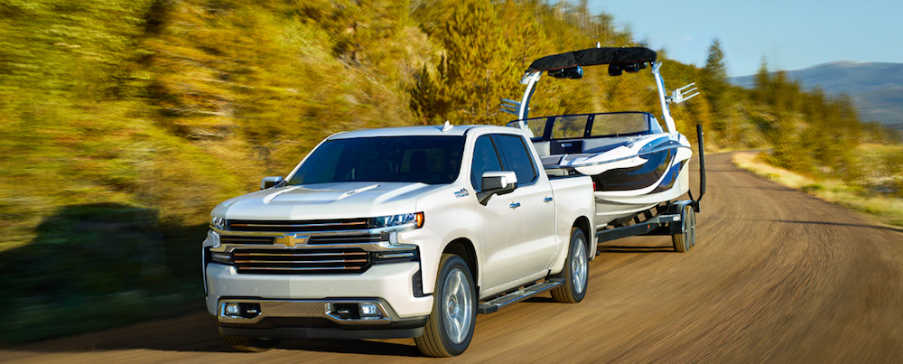 A 2019 Chevrolet Silverado towing a boat