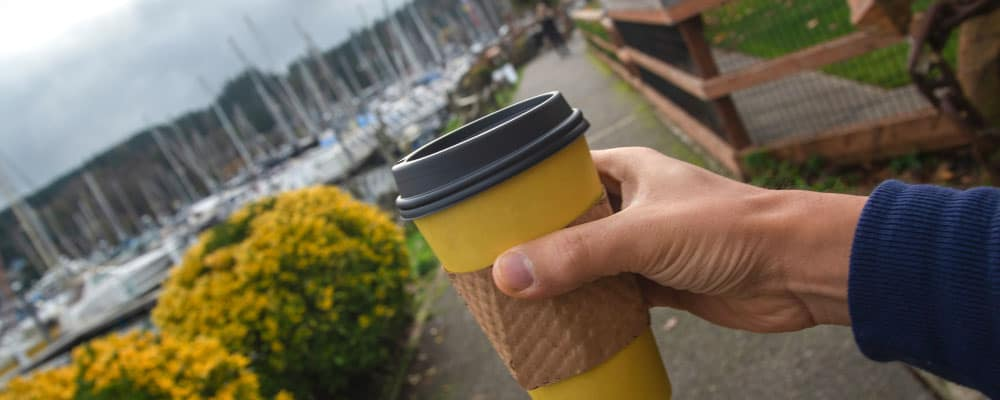exploring the Seattle waterfront with coffee