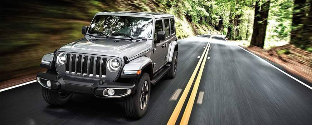 2019 Jeep Wrangler on forest path