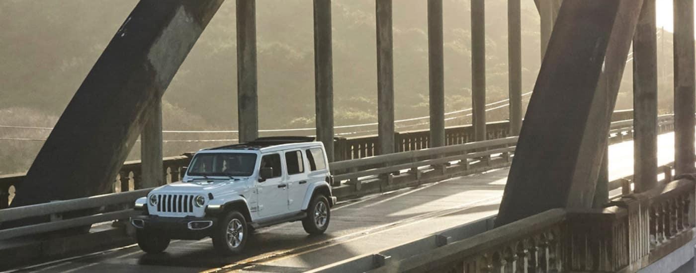 jeep wrangler driving over bridge
