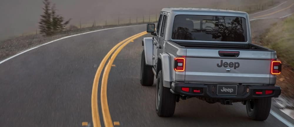 jeep-gladiator-driving-through-mountain-street