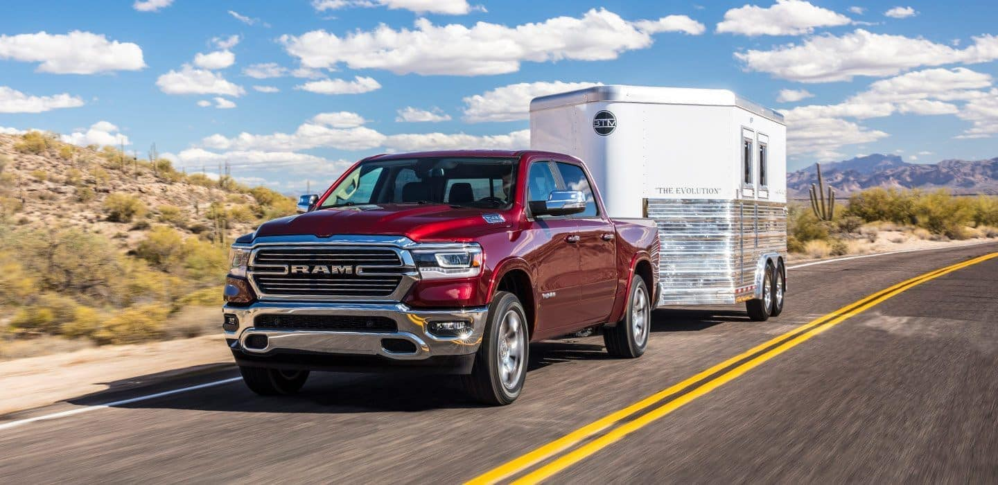 2019 RAM 1500 towing trailer down road