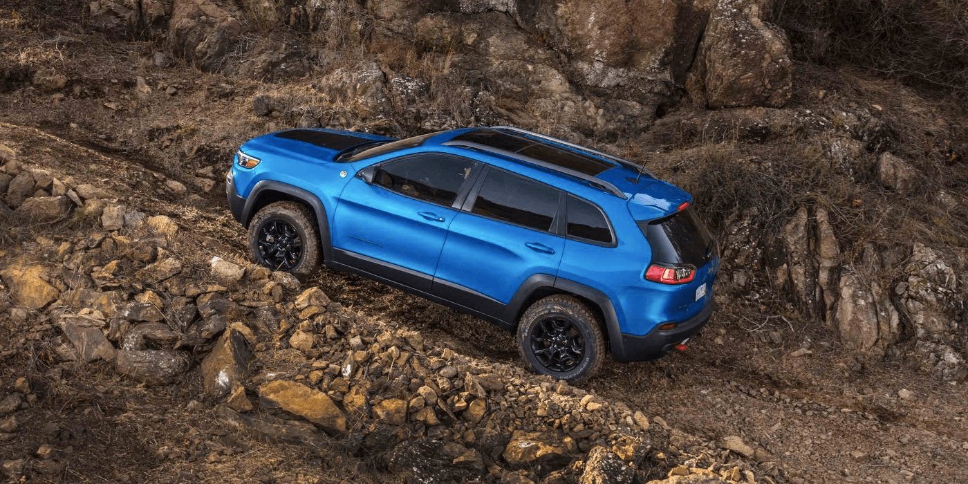 2019 Jeep Cherokee driving up unpaved path
