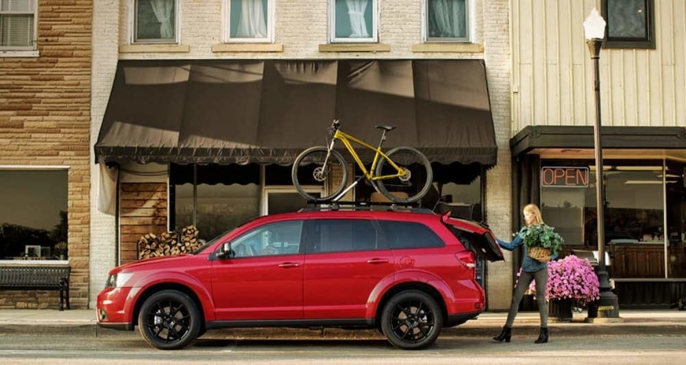 2019 Dodge Journey in red with bike on roof rack