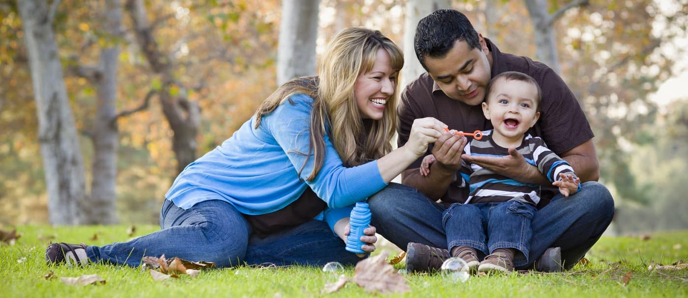family enjoying themselves at park