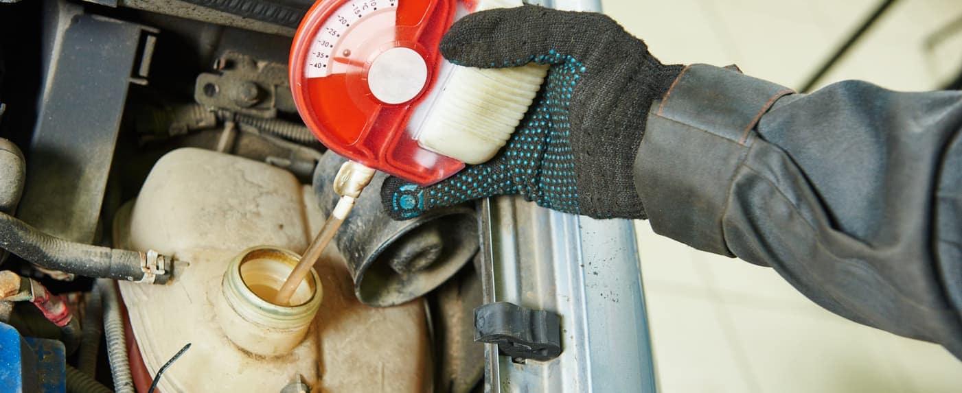 mechanic checking antifreeze