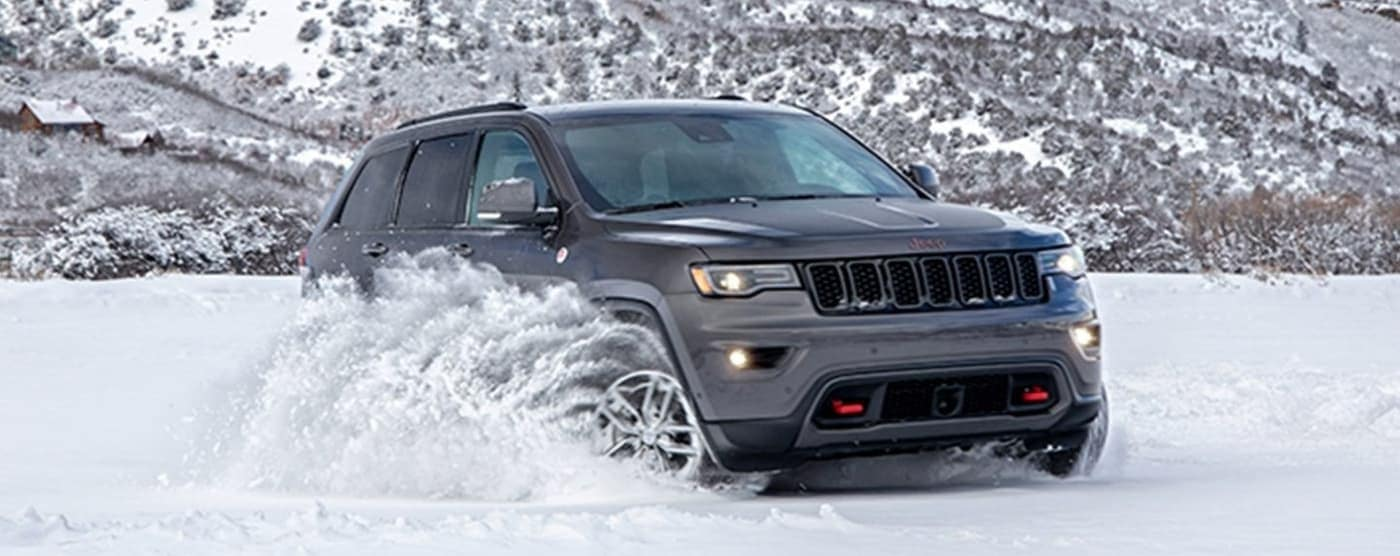 2020 Jeep Grand Cherokee driving in snow