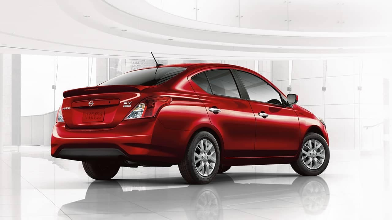 Red Nissan Versa in showroom