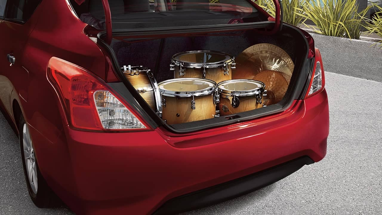 Nissan Versa trunk filled with drums