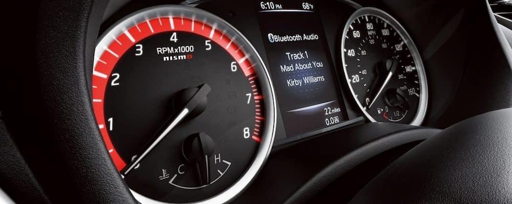 closeup of Sentra dash, focusing on display and gauges