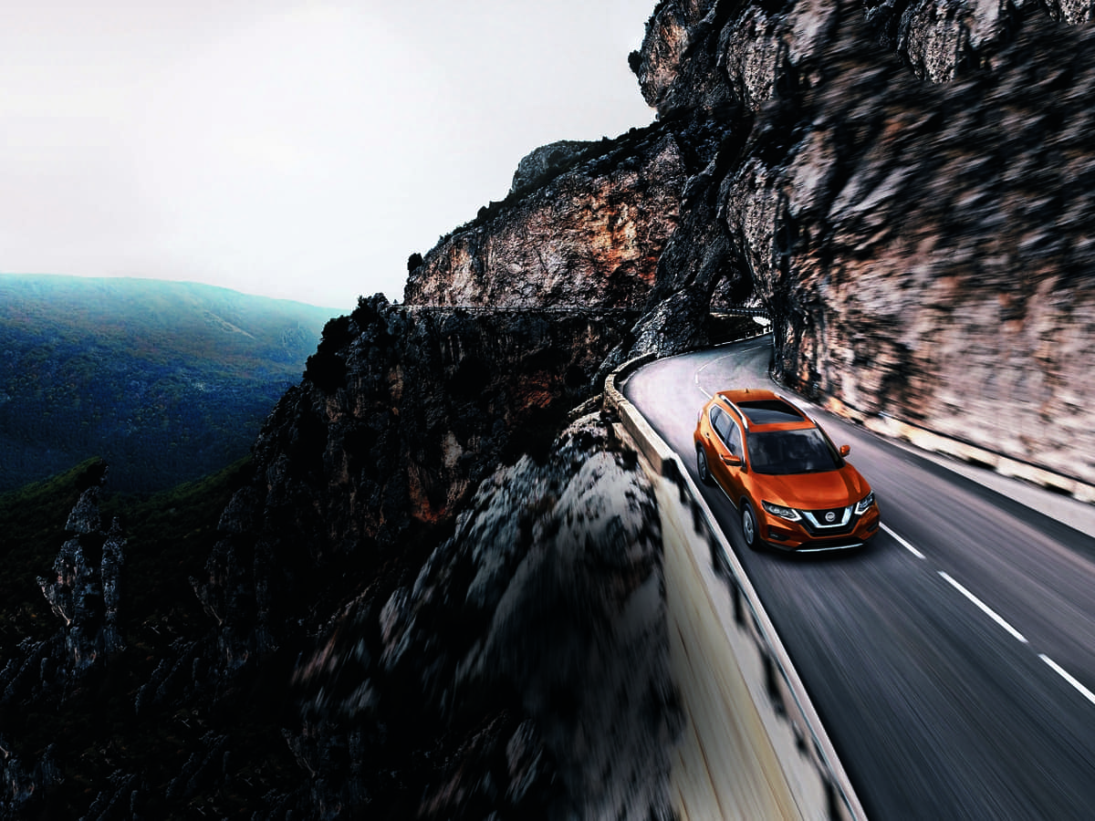2019 Nissan Rogue driving on mountain road